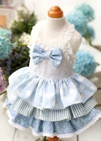Juny Bell - Bianca - This dress is simply beautiful.  Embroidered eyelet bodice is accented with bow, and has elastic lace shoulder straps.  Various sky colored fabrics create the 3-tiered ruffle skirt.